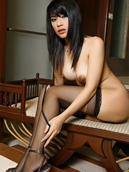 Wanda Tai In Black Stockings