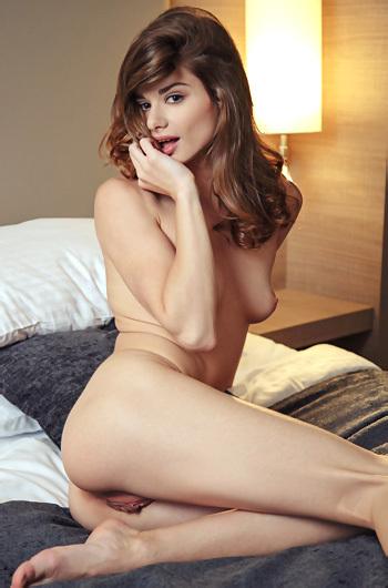 Loretta Strips On A Bed
