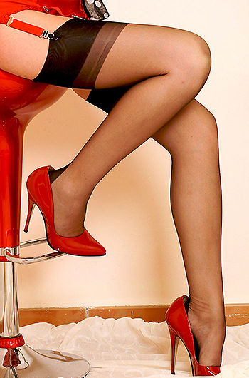 Blond Girl Posing In Stockings And Red Heels