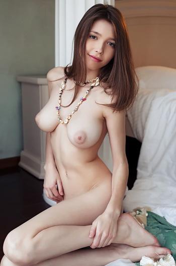 Busty Mila Posing In Her Bedroom
