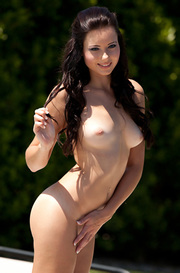 Natasha Belle Strips Outside