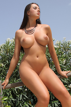 Busty Winona Is Naked In The Garden